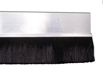 Brush seal weatherstrip for garage doors
